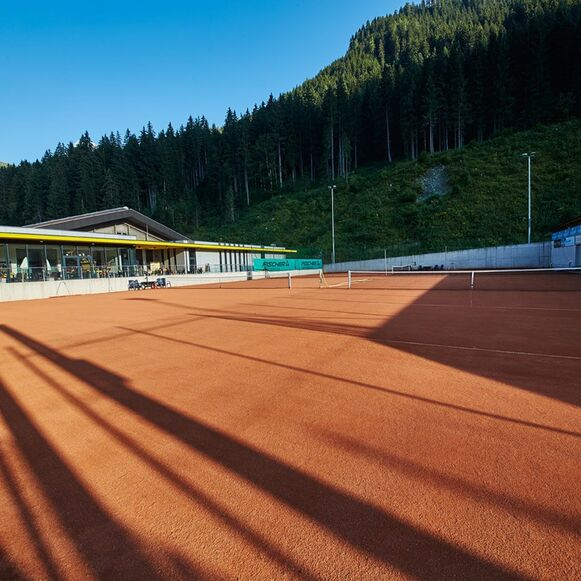 Playing tennis in Saalbach Hinterglemm.